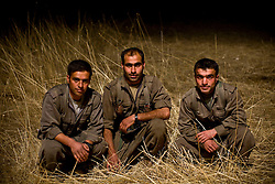 PKK guerilla fighters from left to right: Kazim Siirt, 29, Gorse Mereto, 32, and Serhildan Ruges, 29, sit for a portrait in Qandil Mountains, Iraqi Kurdistan.