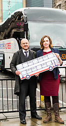 Pictured: Patrick Harvie and Sarah Beattie-Smith<br /> <br /> Scottish Green Party co-convener Patrick Harvie and Scottish Greens infrastructure and transport spokeswoman Sarah Beattie-Smith met bus travellers at a busy intersection in Edinburgh as part of the party's Better Bus campaign <br /> Ger Harley | EEm 5 April 2016