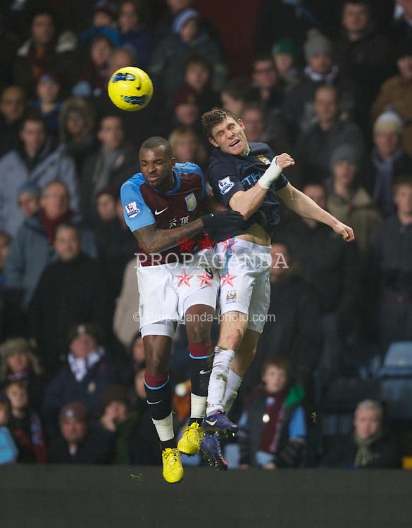 BIRMINGHAM, ENGLAND - Sunday, February 12, 2012: Manchester City's James Milner in action against Aston Villa's Darren Bent during the Premiership match at Villa Park. (Pic by David Rawcliffe/Propaganda)