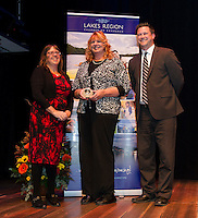 Executive Director Karmen Gifford presents the J Bart Conners Award to Christine Harris with guest speaker Kevin Skarupa of WMUR during the Lakes Region  Chamber of Commerce 2015 Community Hero Awards at the Winnipesaukee Playhouse on Tuesday evening.  (Karen Bobotas/for the Laconia Daily Sun)
