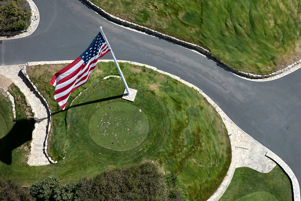 An American flag stands at the Trump National Golf Club, Los Angeles in this aerial photograph taken during the historic drought over Rancho Palos Verdes, California, U.S., on Monday, August 31, 2015. Owned by The Trump Organization, the course was formerly known as Ocean Trails Golf Club, an 18-hole course designed by Pete Dye, which was about to open when a landslide occurred. Donald Trump bought the property known for it's views of the Pacific Ocean in 2002. © 2015 Patrick T. Fallon