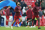 Liverpool forward Mohamed Salah (11) and Liverpool forward Sadio Mane (10) warming up during the Champions League Quarter-Final Leg 1 of 2 match between Liverpool and FC Porto at Anfield, Liverpool, England on 9 April 2019.