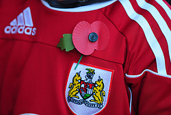 Bristol City fans displays a poppy for remembrance day - Photo mandatory by-line: Joe Meredith/JMP  - Tel: Mobile:07966 386802 11/11/2012 - Bristol City v Charlton Athletic - SPORT - FOOTBALL - Championship -  Bristol  - Ashton Gate Stadium -