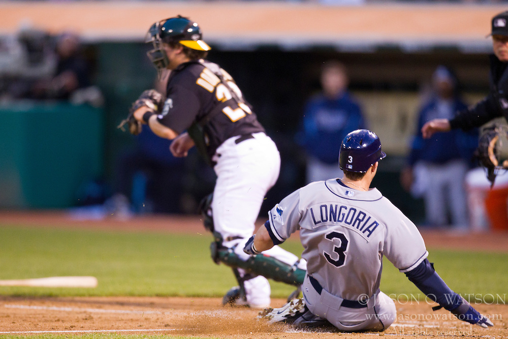 May 7, 2010; Oakland, CA, USA;  Tampa Bay Rays third baseman Evan Longoria (3) beats a throw to Oakland Athletics catcher Josh Donaldson (29) to score a run during the fourth inning at Oakland-Alameda County Coliseum. Tampa Bay defeated Oakland 4-1.