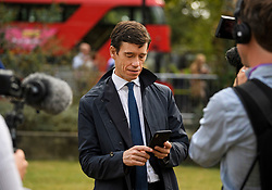 © Licensed to London News Pictures. 04/09/2019. London, UK. RORY STEWART MP is seen reading out a text message he received, informing him he had been expelled form the Conservative Party, during an interview in Westminster, London. British Prime Minister Boris Johnson has a called for a general election after losing his first commons vote and losing his majority, removing his control of parliament. Photo credit: Ben Cawthra/LNP