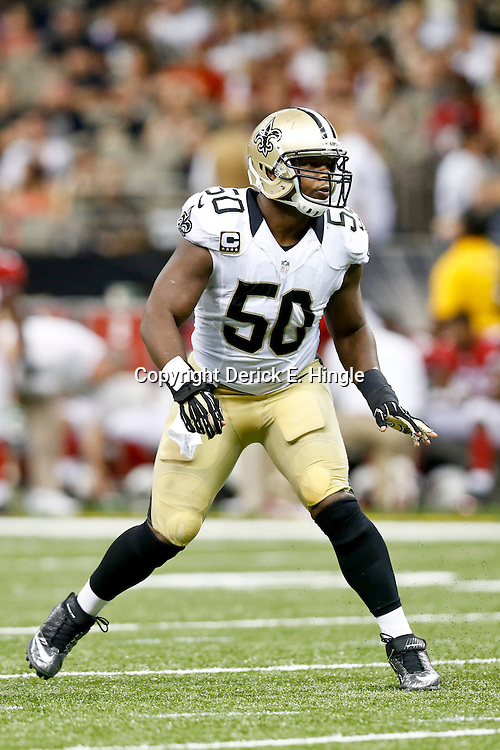 Sep 22, 2013; New Orleans, LA, USA; New Orleans Saints middle linebacker Curtis Lofton (50) against the Arizona Cardinals during a game at Mercedes-Benz Superdome. The Saints defeated the Cardinals 31-7. Mandatory Credit: Derick E. Hingle-USA TODAY Sports