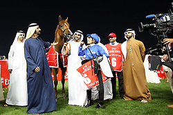 Silvestre De Sousa, the jockey of African Story, celebrates his $10,000,000 Dubai World Cup race win with Sheikh Mohammed bin Rashid Al Maktoum, UAE prime minister and ruler of Dubai (2nd from L), and Sheikh Hamdan Bin Mohammed Bin Rashid Al Maktoum, Dubai crown prince, (C) at the Meydan in Dubai, United Arab Emirates, Saturday March 29, 2014. With a total prize purse of US$27.25 million, the 19th running of Dubai World Cup is the world's richest day of racing. Picture by Randi Sokoloff / i-Images