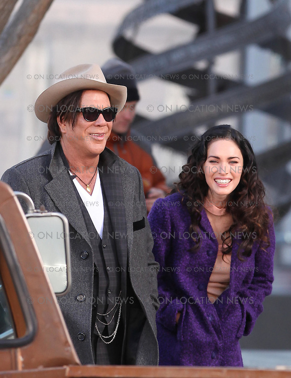 January 9th, 2010. Albuquerque, New Mexico. NON-EXCLUSIVE PHOTO. Megan Fox and Mickey Rourke film a scene togethers for Passion Play. In the scene Megan and Mickey walk down the street holding hands then Megan tenderly kisses Mickey on the cheek before they get in to an old beat up truck together. In between takes Megan was seen laughing at Mickeys jokes. Photo by Danny Mayer/ Eric Ford/ On Location News. 818-613-3955. info@onlocationnews.com