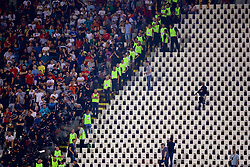 BELGRADE, SERBIA - Sunday, June 11, 2017: Serbia supporters are held back by armed police during the 2018 FIFA World Cup Qualifying Group D match between Wales and Serbia at the Red Star Stadium. (Pic by David Rawcliffe/Propaganda)