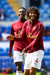 Danny Welbeck of Arsenal laughs with Mohamed Elneny of Arsenal - Mandatory by-line: Ryan Hiscott/JMP - 02/09/2018 -  FOOTBALL - Cardiff City Stadium - Cardiff, Wales -  Cardiff City v Arsenal - Premier League