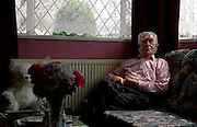 The Catford prefabs estate in South London, 2004. One resident in his living room. Thousands of post-war prefabs are still being lived in and cherished by their tenants or owners all over the UK.