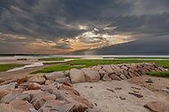 A shelf cloud and sunbeams in the skies above Paine's Creek Beach