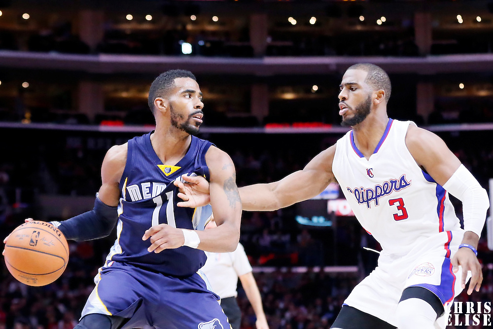 23 February 2015: Los Angeles Clippers guard Chris Paul (3) defends on Memphis Grizzlies guard Mike Conley (11) during the Memphis Grizzlies 90-87 victory over the Los Angeles Clippers, at the Staples Center, Los Angeles, California, USA.