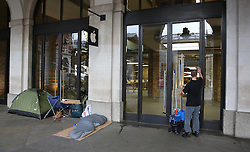 © Licensed to London News Pictures. 24/09/2015. London, UK.  iPhone fans (L) are seen camped outside the Apple Store in Covent Garden a full 24 hours before the new iPhone 6S goes on sale. Photo credit: Peter Macdiarmid/LNP