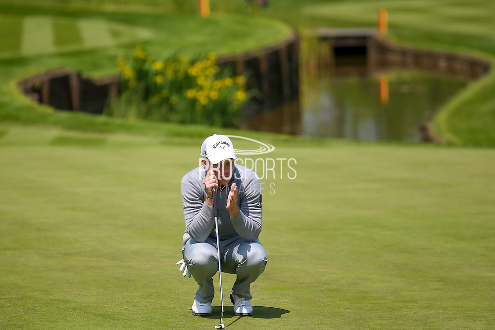 English golf professional Danny Willett contemplates his eagle putt on the 18th at the  BMW PGA Championship at the Wentworth Club, Virginia Water, United Kingdom on 27 May 2016. Photo by Simon Davies.