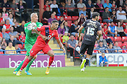 York City forward Vadaine Oliver challenges Mansfield Town goalkeeper Brian Jensen during the Sky Bet League 2 match between York City and Mansfield Town at Bootham Crescent, York, England on 29 August 2015. Photo by Simon Davies.