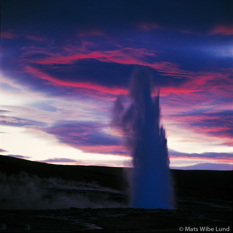 Strokkur, fountain geyser in the geothermal area of Haukadalur Iceland.