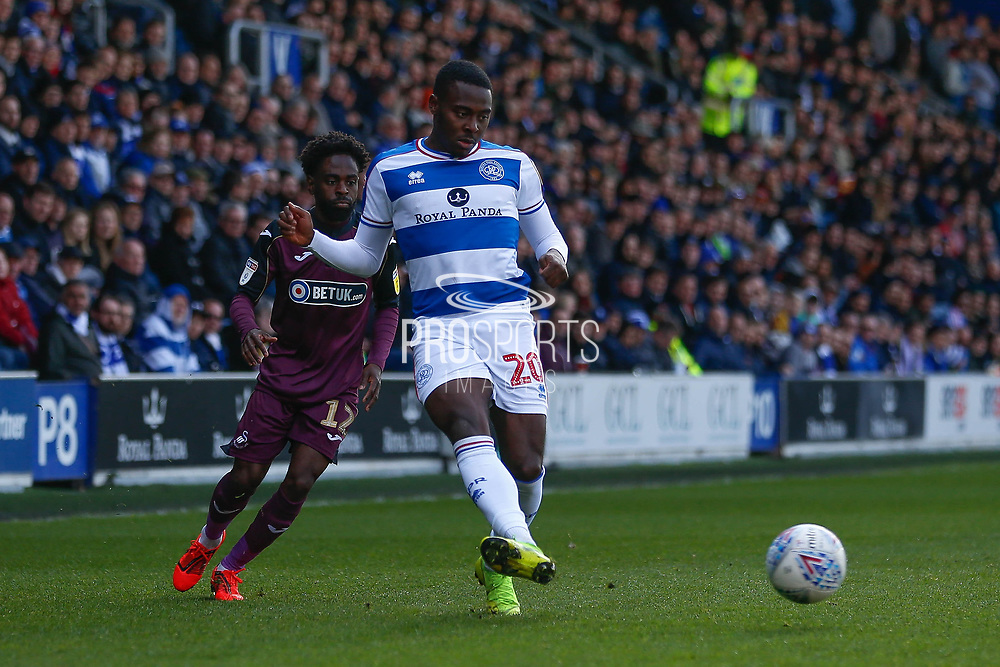 Queens Park Rangers midfielder Bright Osayi-Samuel (20) passes the ball, Swansea City midfielder Nathan Dyer (12) in picture, during the EFL Sky Bet Championship match between Queens Park Rangers and Swansea City at the Loftus Road Stadium, London, England on 13 April 2019.