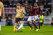 Ryan Hedges (#11) of Aberdeen FC shields the ball from Clevid Dikamona (#28) of Heart of Midlothian FC during the Ladbrokes Scottish Premiership match between Heart of Midlothian FC and Aberdeen FC at Tynecastle Stadium, Edinburgh, Scotland on 29 December 2019.