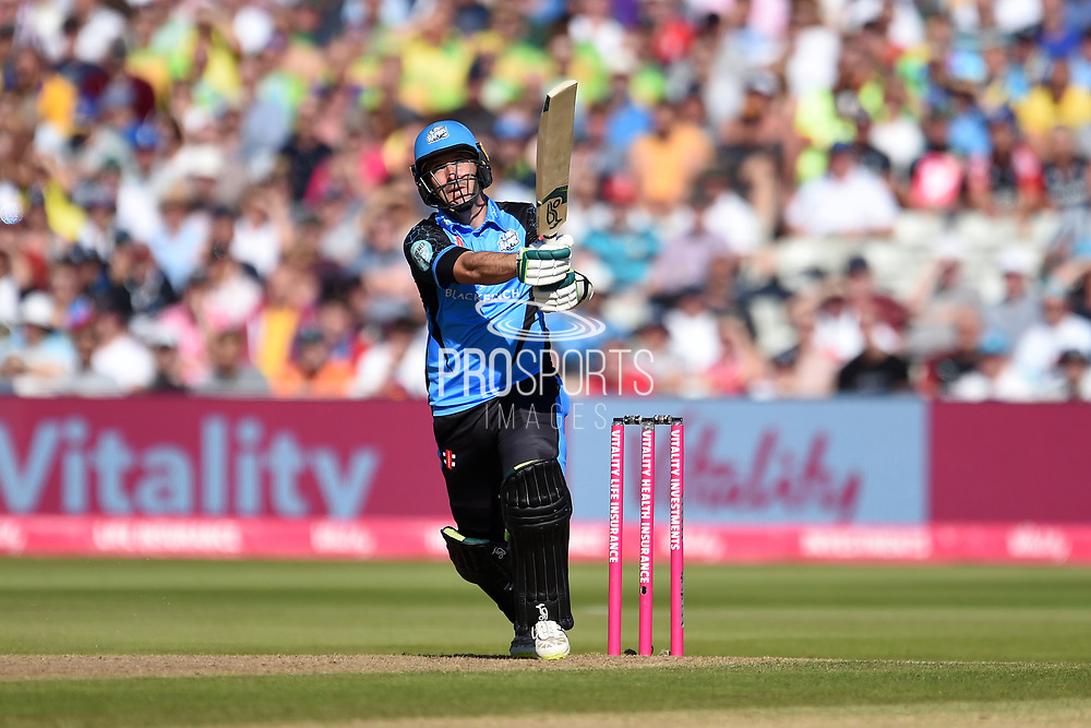 Daryl Mitchell of Worcestershire Rapids hits a six down the ground in the final over of Worcestershire Rapids Innings during the Vitality T20 Finals Day 2019 match between Notts Outlaws and Worcestershire Rapids at Edgbaston, Birmingham, United Kingdom on 21 September 2019.