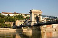 Early morning sailing under the Chain Bridge over the Danube River, Budapest, Hungary