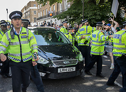 © Licensed to London News Pictures. 24/06/2016. London, UK. Boris Johnson's car is police escorted as local people jeer  as he leaves home after the UK EU referendum result was announced with a victory for the leave campaign. Photo credit: Peter Macdiarmid/LNP