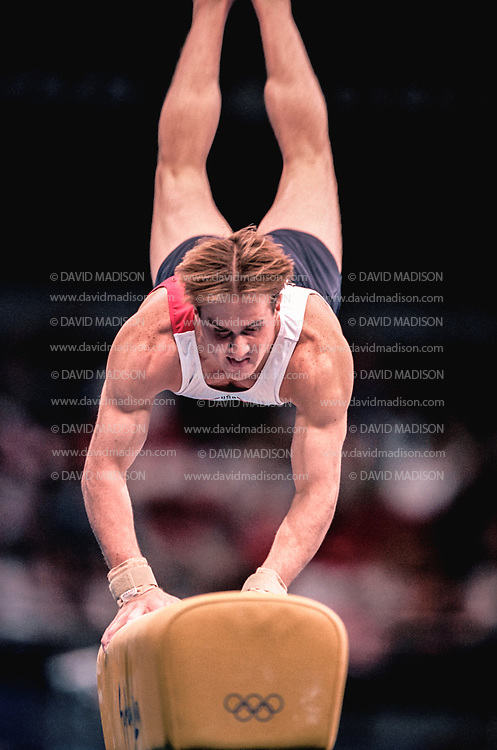 SYDNEY - SEPTEMBER 1:  Morgan Hamm of the United States competes on the vault during the Men's Gymnastics events of the Olympic Games during September 2000 in Sydney, Australia.  (Photo by David Madison/Getty Images)