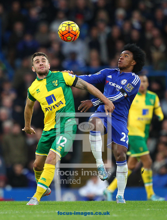 Robbie Brady of Norwich and Willian of Chelsea in action during the Barclays Premier League match at Stamford Bridge, London<br /> Picture by Paul Chesterton/Focus Images Ltd +44 7904 640267<br /> 21/11/2015