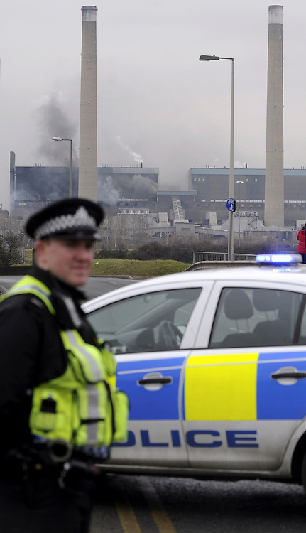 © Licensed to London News Pictures. 27/02/2012. Tilbury, UK. POlice cordon off the entrance to Tolbury power station in Essex where a fire has broken out in areas containing about 4,000 tonnes of wood pellets. The  blaze at Tilbury Power Station in the Thames estuary began just before 08:00 am this morning (27/02/2012) and quickly engulfed the building in smoke. Photo credit : Grant Falvey/LNP