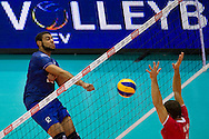(L) Earvin Ngapeth from France spikes the ball during the 2013 CEV VELUX Volleyball European Championship match between France and Turkey at Ergo Arena in Gdansk on September 22, 2013.<br /> <br /> Poland, Gdansk, September 22, 2013<br /> <br /> Picture also available in RAW (NEF) or TIFF format on special request.<br /> <br /> For editorial use only. Any commercial or promotional use requires permission.<br /> <br /> Mandatory credit:<br /> Photo by © Adam Nurkiewicz / Mediasport
