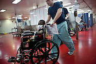 A young boy is pushed in a wheel chair on board the USNS Comfort, a naval hospital ship, on Wednesday, January 20, 2010 in Port-Au-Prince, Haiti. The Comfort deployed from Baltimore, bringing nearly a thousand medical personnel to care for victims of Haiti's recent earthquake.