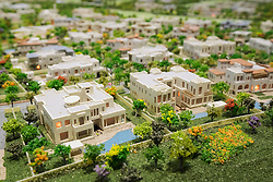 Model of new luxury villas at Dubai Hills Estate by developer Emaar at property trade fair in Dubai United Arab Emirates