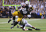 October 2 2010: Penn State Nittany Lions linebacker Nathan Stupar (34) and Penn State Nittany Lions safety Andrew Dailey (13) hit Iowa Hawkeyes tight end Allen Reisner (82) during the first half of the NCAA football game between the Penn State Nittany Lions and the Iowa Hawkeyes at Kinnick Stadium in Iowa City, Iowa on Saturday October 2, 2010. Iowa defeated Penn State 24-3.