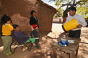 Demonstrating the Sawyer water filter in Isosog, Santa Cruz, Bolivia