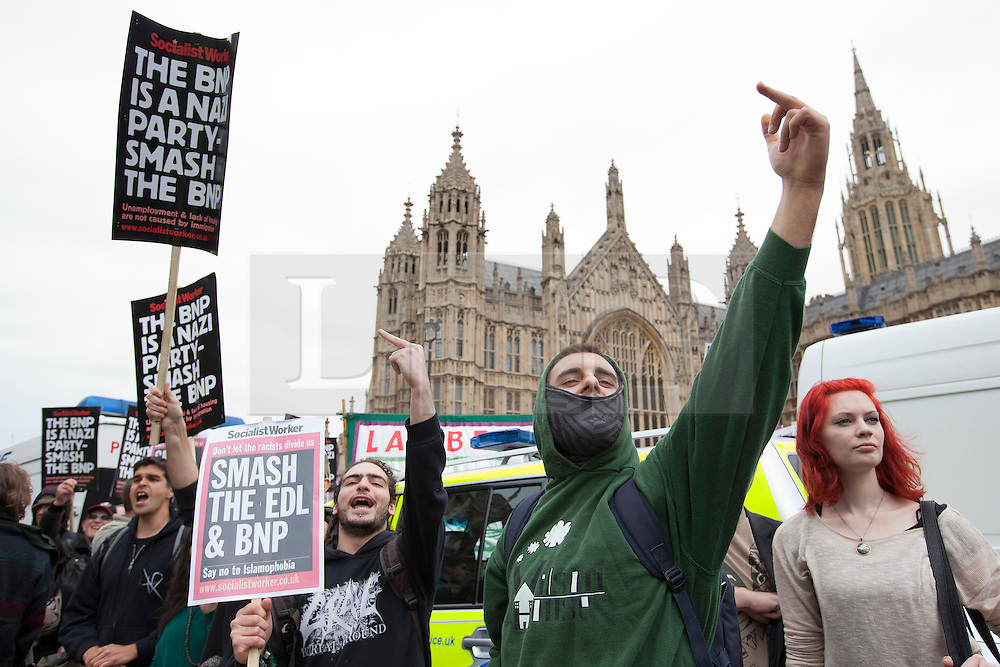 © Licensed to London News Pictures. 01/06/2013. London, UK. A Unite Against Fascism (UAF) supporter reacts to British National Party (BNP) members after the UAF broke through a police cordon during protests by both groups in central London today (01/06/2013). The BNP protest was held in response to the killing of Drummer Lee Rigby, who died after an attack in Woolwich where religious extremism may have been the motive. Photo credit: Matt Cetti-Roberts/LNP