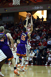 30 January 2007: Levi Dyer shoots over Bradley Strickland.  The Purple Aces of Evansville folded the final 2 minutes of play and handed the game to Illinois State University Redbirds by a score of 65-61at Redbird Arena in Normal Illinois.