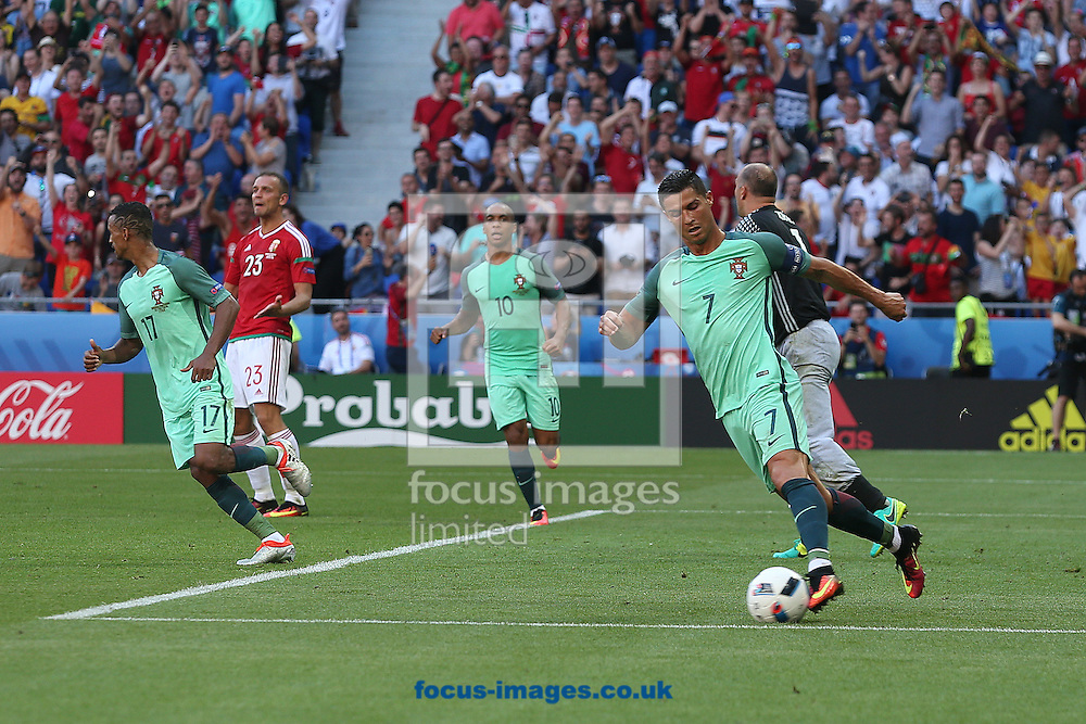 Cristiano Ronaldo of Portugal back to the halfway line with the ball after scoring his side'e 3rd goal during the UEFA Euro 2016 match at Stade de Lyons, Lyons<br /> Picture by Paul Chesterton/Focus Images Ltd +44 7904 640267<br /> 22/06/2016