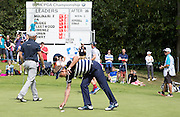 Luke DONALD picking his ball up on the 18th during the 4th day of the BMW PGA Championship at Wentworth, Virginia Water, United Kingdom on 24 May 2015. Photo by Ellie  Hoad.