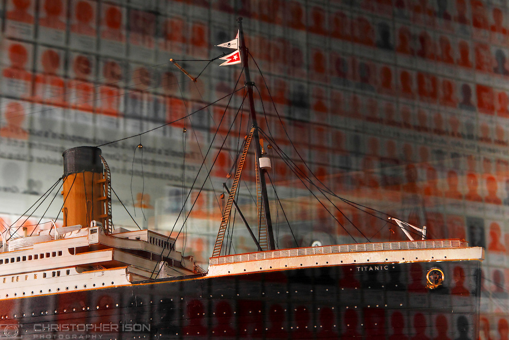 Silhouettes of victims of the Titanic disaster are reflected in the glass of a display case containing a scale model of the ill-fated White Star liner at Southampton's new Sea City Museum. The orange coloured figures represent the 549 victims who gave their addresses as Southampton. In total 1,514 passengers and crew died on the night of April 14th, 1912. The new museum opens on April 10th, the centenary of the day RMS Titanic left Southampton for America.
