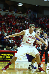 07 January 2012:  Jordan Threloff screens out Rokas Cesnulevicus during a free throw during an NCAA Missouri Valley Conference mens basketball game Where the Purple Aces of Evansville lost to the Illinois State Redbirds 75-73 in Redbird Arena, Normal IL