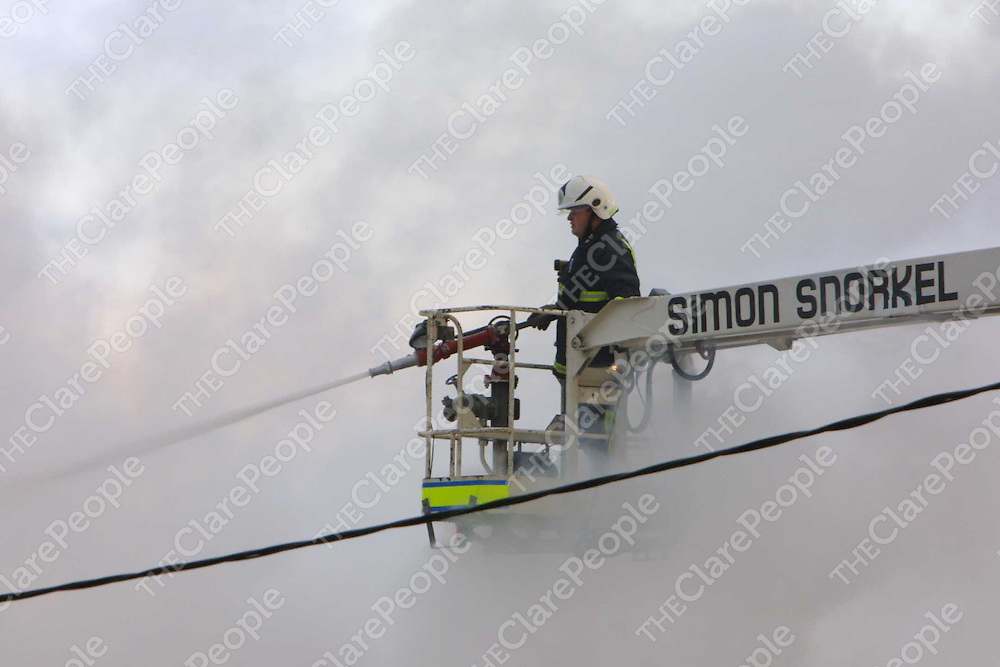 Fire fighters from Ennis and Ennistymon at the scene of Fridays fire at a garage in Kilmaley. Picture:Press 22