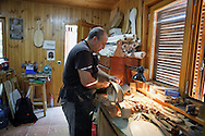 10/08/2016. Luthier Carlos Doviso works on a Oval Viol or Oval Fiddle in a workshop on August 10, 2016 in Pelayos de la Presa, Madrid province, Spain. The Collegiate of Santa María la Mayor is a Romanesque architecture church built during the 12th and 13th centuries. Recents restorations of the Church discovered many details on its sculptures, and luthiers found the opportunity of recovering and to reproduce instruments showing on its North gate. (© Pablo Blazquez)
