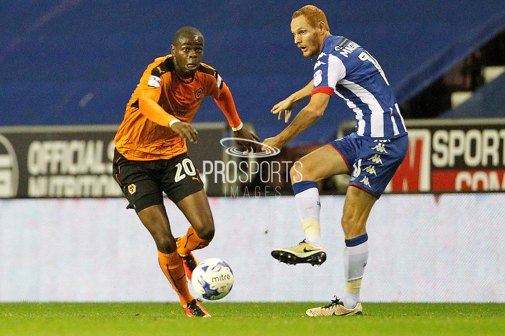 Wigan's Shaun MacDonald and Wolves Prince Oniangue during the EFL Sky Bet Championship match between Wigan Athletic and Wolverhampton Wanderers at the DW Stadium, Wigan, England on 27 September 2016. Photo by Craig Galloway.