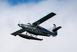De Havilland Canada DHC-3T Vazar Turbine Otter (N3952B) operated by Taquan Air flying near Ketchikan Harbor Seaplane Base (5KE), Ketchikan, Alaska, United States of America