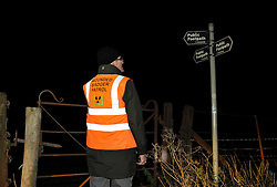 © Licensed to London News Pictures. 10/10/2013.  Forthampton, Gloucestershire, UK.  The Wounded Badger Patrol in Gloucestershire, where patrollers go out looking for dead or wounded badgers on public footpaths and roads.  The Government has licensed a pilot badger cull in parts of Somerset and Gloucestershire as part of efforts to reduce bovine tuberculosis in cows on farms and is considering extending the cull as the targets for culled badgers have not been met.  10 October 2013.<br /> Photo credit : Simon Chapman/LNP