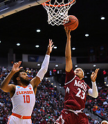 SAN DIEGO, CA - MARCH 16:  Zach Lofton #23 of the New Mexico State Aggies drives in for a layup against Gabe DeVoe #10 of the Clemson Tigers during a first round game of the Men's NCAA Basketball Tournament at Viejas Arena in San Diego, California. Clemson won 79-68.  (Photo by Sam Wasson)