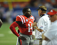Mississippi Rebels linebacker Serderius Bryant (14) talks with Ole Miss head coach Hugh Freeze after being ejected for targeting vs. Boise State at the Georgia Dome in Atlanta, Ga. on Thursday, August 28, 2014. Ole Miss won 35-13.