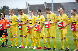 LLANELLI, WALES - Saturday, September 15, 2012: Newtown players with 'Show Racism The Red Card' banners during the Welsh Premier League match against Llanelli at Stebonheath Park. (Pic by David Rawcliffe/Propaganda)