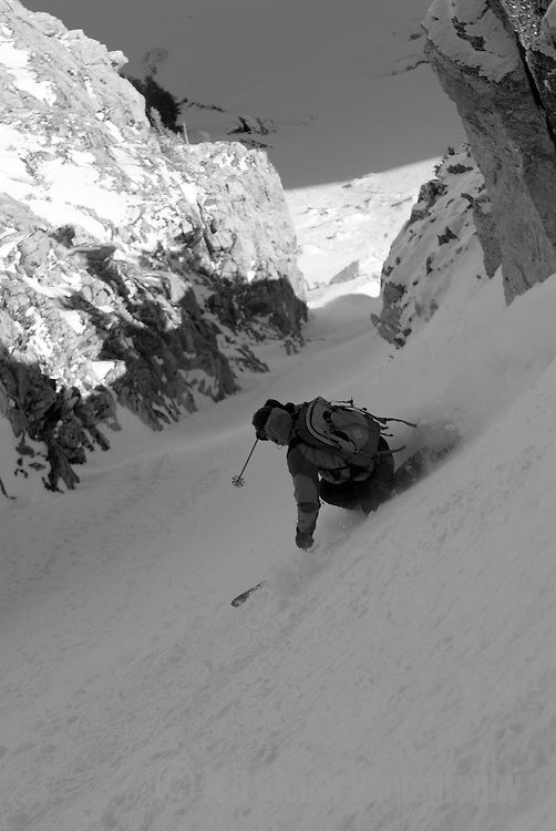 A young man skis the Sliver Couloir on Nez Perce Peak, Grand Teton National Park, Jackson Hole, Wyoming.