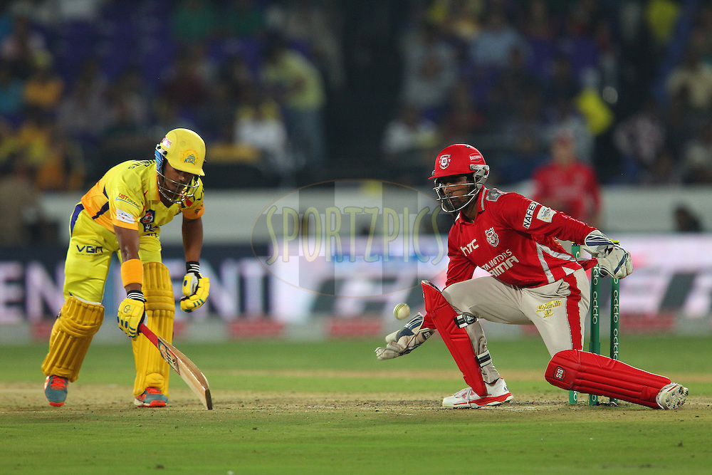 Pawan NEGI of the Chennai Superkings makes it back as Wriddhiman SAHA of the Kings XI Punjab gathers the ball during the second semi final match of the Oppo Champions League Twenty20 between the Kings XI Punjab and the Chennai Superkings held at the Rajiv Gandhi Cricket Stadium, Hyderabad, India on the 2nd October 2014<br /> <br /> Photo by:  Ron Gaunt / Sportzpics/ CLT20<br /> <br /> <br /> Image use is subject to the terms and conditions as laid out by the BCCI/ CLT20.  The terms and conditions can be downloaded here:<br /> <br /> http://sportzpics.photoshelter.com/gallery/CLT20-Image-Terms-and-Conditions-2014/G0000IfNJn535VPU/C0000QhhKadWcjYs